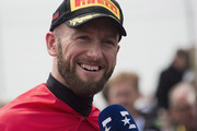 Tom Sykes of Great Britain and KAWASAKI RACING TEAM WorldSBK speaks with journalis and celebrates the Super Pole during the Motul FIM Superbike World Championship - Race One at Donington Park on May 26, 2018 in Castle Donington, England.