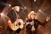 Willie Nelson (L) and Brandi Carlile perform at MusiCares Person of the Year honoring Dolly Parton at Los Angeles Convention Center on February 8, 2019 in Los Angeles, California.