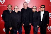(L-R) Musicians Steve Berlin, Conrad Lozano, David Hidalgo, Louie Perez, and Cesar Rosas of Los Lobos attend the 25th anniversary MusiCares 2015 Person Of The Year Gala honoring Bob Dylan at the Los Angeles Convention Center on February 6, 2015 in Los Angeles, California. The annual benefit raises critical funds for MusiCares' Emergency Financial Assistance and Addiction Recovery programs. For more information visit musicares.org.
