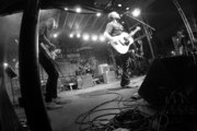 This image was taken with a GoPro and converted to black and white.) Kings of Leon perform onstage at the Music City Food + Wine Festival Harvest Night Presented By Infiniti on September 20, 2014 in Nashville, Tennessee.