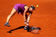 Sabine Lisicki of Germany stretches to play a backhand against Carla Suarez Navarro of Spain in their second round match during day four of the Mutua Madrid Open tennis tournament at the Caja Magica on May 03, 2016 in Madrid,Spain.