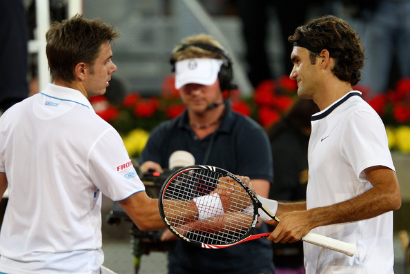 Roger Federer of Switzerland shakes hands at the net after his straight sets victory against Stanislas Wawrinka of Switzerland in their third round match during the Mutua Madrilena Madrid Open tennis tournament at the Caja Magica on May 13, 2010 in Madrid, Spain.