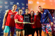 (L-R) Conor Dwyer, Caitlin Leverenz, Eugene Godsoe, Cammile Adams, Jessica Hardy, and Matt Grevers pose with the trophy after winning the Mutual of Omaha Duel in the Pool at Indiana University Natatorium on December 12, 2015 in Indianapolis, Indiana.