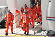 Space Shuttle Atlantis Pilot Tony Antonelli (L-R), Mission Specialists Garrett Reisman, Steve Bowen Commander Ken Ham, Mission specialists Michael Good and Piers Sellers walk out of NASA's operations and checkout building and into the astronaut van at Kennedy Space Center May 14, 2010 in Cape Canaveral in preparation for their launch later today. This is scheduled to be the final launch for Atlantis.