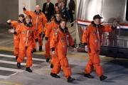 NASA's STS-131 astronauts (R-L) Commander Alan Poindexter, Pilot James P. Dutton Jr., mission specialist Rick Mastracchio, Stephanie Wilson, NASA atronaut Clayton Anderson, mission specialist Dorothy Metcalf-Lindenburger and Japan Aerospace Exploration Agency astronaut Naoko Yamazaki walk out of the operations and checkout building at Kennedy Space Center on April 5, 2010 in Cape Canaveral, Florida. The shuttle crew is scheduled to launch later today for a 13 day trip to the International Space Station.