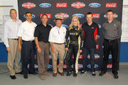(L-R) Mike Kozak from NASCAR, Jamie Allison from Ford Racing,NASCAR driver Greg Biffle, Jack Rouch CEO, and co-owner of Roush Fenway Racing, Jaclyn Roney, Miss Sprint Cup, NASCAR driver Matt Kenseth and NASCAR driver Carl Edwards pose for a photo at a NASCAR After The Lap Launch sponsored by Ford and Coca-Cola announcement on August 16, 2012 at the Ford Dearborn truck plant, in Dearborn Michigan.