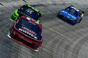 Ty Dillon, driver of the #3 Red Kap/Kohls.com Chevrolet, leads Joey Logano, driver of the #22 Fitzgerald Ford, and Daniel Suarez, driver of the #19 Juniper Networks Toyota, during the NASCAR XFINITY Series Fitzgerald Glider Kits 300 Heat #2 at Bristol Motor Speedway on April 16, 2016 in Bristol, Tennessee.