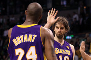 Kobe Bryant #24 and Pau Gasol #16 of the Los Angeles Lakers celebrate in the final moments of the Lakers' win over the Boston Celtics in Game Three of the 2010 NBA Finals on June 8, 2010 at TD Garden in Boston, Massachusetts. NOTE TO USER: User expressly acknowledges and agrees that, by downloading and/or using this Photograph, user is consenting to the terms and conditions of the Getty Images License Agreement.