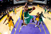 Glen Davis #11 of the Boston Celtics goes to the basket against Kobe Bryant #24 and Pau Gasol #16 of the Los Angeles Lakers in Game Seven of the 2010 NBA Finals at Staples Center on June 17, 2010 in Los Angeles, California.  NOTE TO USER: User expressly acknowledges and agrees that, by downloading and/or using this Photograph, user is consenting to the terms and conditions of the Getty Images License Agreement.