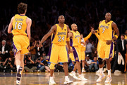(L-R) Pau Gasol #16, Kobe Bryant #24, Derek Fisher #2 and Lamar Odom #7 of the Los Angeles Lakers run up court in Game Seven of the 2010 NBA Finals against the Boston Celtics at Staples Center on June 17, 2010 in Los Angeles, California.  NOTE TO USER: User expressly acknowledges and agrees that, by downloading and/or using this Photograph, user is consenting to the terms and conditions of the Getty Images License Agreement.