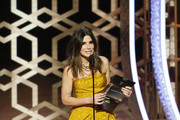 In this handout photo provided by NBCUniversal Media, LLC,  Sandra Bullock speaks onstage during the 77th Annual Golden Globe Awards at The Beverly Hilton Hotel on January 5, 2020 in Beverly Hills, California.