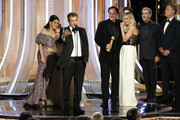"""In this handout photo provided by NBCUniversal Media, LLC,  David Heyman accepts the award for BEST MOTION PICTURE – MUSICAL OR COMEDY for """"Once Upon a Time...in Hollywood"""" onstage, with Shannon McIntosh, Julia Butters, Quentin Tarantino, Margot Robbie, Pierce Brosnan and Will Ferrell, during the 77th Annual Golden Globe Awards at The Beverly Hilton Hotel on January 5, 2020 in Beverly Hills, California."""