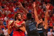 Matt Knight of the Wildcats looks to pass the ball against Ekene Ibekwe and Corey Webster of the Breakers during the NBL round 19 game between the Perth Wildcats and New Zealand Breakers at Perth Arena on February 15, 2015 in Perth, Australia.