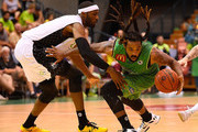 Jordair Jett of the Crocodiles drives to the basket past Hakim Warrick of Melbourne United during the round eight NBL match between the Townsville Crocodiles and Melbourne United on November 26, 2015 in Townsville, Australia.