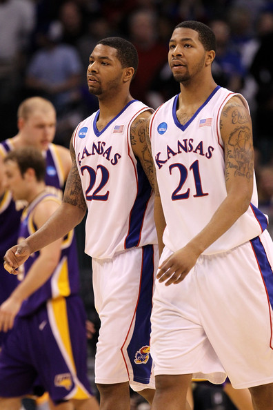 (L-R) Marcus Morris #22 and Markieff Morris #21 of the Kansas Jayhawks walk towards the bench against the Northern Iowa Panthers during the second round of the 2010 NCAA men's basketball tournament at Ford Center on March 20, 2010 in Oklahoma City, Oklahoma.