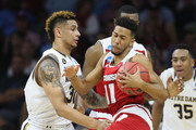 Jordan Hill #11 of the Wisconsin Badgers collides with Zach Auguste #30 of the Notre Dame Fighting Irish during the 2016 NCAA Men's Basketball Tournament East Regional at Wells Fargo Center on March 25, 2016 in Philadelphia, Pennsylvania.