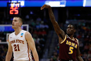 A.J. English #5 of the Iona Gaels reacts after making a shot over Matt Thomas #21 of the Iowa State Cyclones during the first round of the 2016 NCAA Men's Basketball Tournament at the Pepsi Center on March 17, 2016 in Denver, Colorado.