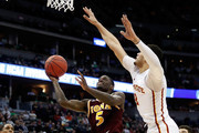 A.J. English #5 of the Iona Gaels makes a shot as he is fouled by Abdel Nader #2 of the Iowa State Cyclones during the first round of the 2016 NCAA Men's Basketball Tournament at the Pepsi Center on March 17, 2016 in Denver, Colorado.
