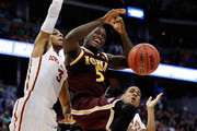 A.J. English #5 of the Iona Gaels loses the ball against Hallice Cooke #3 of the Iowa State Cyclones during the first round of the 2016 NCAA Men's Basketball Tournament at the Pepsi Center on March 17, 2016 in Denver, Colorado.
