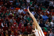 A.J. English #5 of the Iona Gaels drives the ball around Matt Thomas #21 of the Iowa State Cyclones Aduring the first round of the 2016 NCAA Men's Basketball Tournament at the Pepsi Center on March 17, 2016 in Denver, Colorado.
