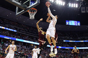 A.J. English #5 of the Iona Gaels fouls Abdel Nader #2 of the Iowa State Cyclones during the first round of the 2016 NCAA Men's Basketball Tournament at the Pepsi Center on March 17, 2016 in Denver, Colorado.
