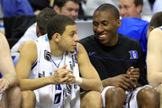 Seth Curry #30 and Nolan Smith #2 of the Duke Blue Devils talk on the bench late in the second half against the Hampton Pirates during the second round of the 2011 NCAA men's basketball tournament at Time Warner Cable Arena on March 18, 2011 in Charlotte, North Carolina.