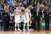 Collin Gillespie #2, Jalen Brunson #1 and head coach Jay Wright of the Villanova Wildcats celebrate a basket vrom the bench against the Alabama Crimson Tide during the first half in the second round of the 2018 NCAA Men's Basketball Tournament at PPG PAINTS Arena on March 17, 2018 in Pittsburgh, Pennsylvania.