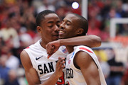 LaBradford Franklin #3 and D.J. Gay #23 of the San Diego State Aztecs celebrate after defeating the Temple Owls 71 to 64 in double overtime during the third round of the 2011 NCAA men's basketball tournament at McKale Center on March 19, 2011 in Tucson, Arizona.