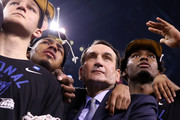 """Head coach Mike Krzyzewski of the Duke Blue Devils watches """"One Shining Moment"""" with his players Grayson Allen #3, Quinn Cook #2 and Justise Winslow #12 after defeating the Wisconsin Badgers during the NCAA Men's Final Four National Championship at Lucas Oil Stadium on April 6, 2015 in Indianapolis, Indiana. Duke defeated Wisconsin 68-63."""