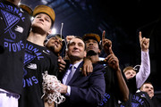 """Head coach Mike Krzyzewski of the Duke Blue Devils watches """"One Shining Moment"""" with his players Grayson Allen #3, Quinn Cook and Justise Winslow #12 after defeating the Wisconsin Badgers during the NCAA Men's Final Four National Championship at Lucas Oil Stadium on April 6, 2015 in Indianapolis, Indiana. Duke defeated Wisconsin 68-63."""