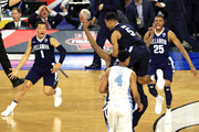 Kris Jenkins #2 of the Villanova Wildcats celebrates with teammates after making the game-winning three pointer to defeat the North Carolina Tar Heels 77-74 in the 2016 NCAA Men's Final Four National Championship game at NRG Stadium on April 4, 2016 in Houston, Texas.