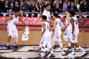 Matt Jones #13, Quinn Cook #2, Jahlil Okafor #15, Tyus Jones #5, Grayson Allen #3 and Justise Winslow #12 of the Duke Blue Devils react after a play in the first half against the Michigan State Spartans during the NCAA Men's Final Four Semifinal at Lucas Oil Stadium on April 4, 2015 in Indianapolis, Indiana.