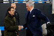 (L-R) Retired American professional stock car racing driver Jeff Gordon talks with Carolina Panthers owner Jerry Richardson prior to the NFC Championship Game between the Arizona Cardinals and the Carolina Panthers at Bank of America Stadium on January 24, 2016 in Charlotte, North Carolina.