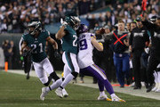 Adam Thielen #19 of the Minnesota Vikings is blocked by Rodney McLeod #23 as Patrick Robinson #21 of the Philadelphia Eagles returns an interception for a touchdown during the first quarter in the NFC Championship game at Lincoln Financial Field on January 21, 2018 in Philadelphia, Pennsylvania.