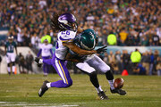 Torrey Smith #82 of the Philadelphia Eagles attempts to catch a pass defended by Trae Waynes #26 of the Minnesota Vikings during the first quarter in the NFC Championship game at Lincoln Financial Field on January 21, 2018 in Philadelphia, Pennsylvania.