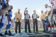 Mike Kelly watches the official coin toss prior to the game between the Buffalo Bills and the New York Giants at the 2014 NFL Hall of Fame Game at Fawcett Stadium on August 3, 2014 in Canton, Ohio.