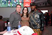 Professional football player Chris Ivory (L) celebrates with guests at the Super Bowl at the Verizon Power House Super Bowl viewing party at Bryant Park on February 2, 2014 in New York City.