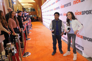 Actors Benjamin Flores Jr. (L) and Breanna Yde attend NICKSPORTS special screening and party for Little Ballers Documentary at Chelsea Piers on February 14, 2015 in New York City.