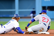 Addison Russell #27 of the Chicago Cubs tags out Justin Turner #10 of the Los Angeles Dodgers at second base as Turner is thrown out by the Willson Contreras #40 in the first inning in game four of the National League Championship Series at Dodger Stadium on October 19, 2016 in Los Angeles, California.