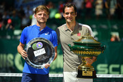 Roger Federer of Switzerland (R) and David Goffin of Belgium pose for photographers after the final match of the Noventi Open at Gerry Weber Stadium on June 23, 2019 in Halle, Germany.
