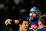 Will Tupou (L) of the Cowboys celebrates with Johnathan Thurston after scoring the winning try during the round 20 NRL match between the North Queensland Cowboys and the Newcastle Knights at Dairy Farmers Stadium on July 24, 2010 in Townsville, Australia.