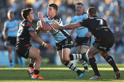 Chad Townsend of the Sharks Is tackled during the round 23 NRL match between the Cronulla Sharks and the New Zealand Warriors at Shark Park on August 24, 2019 in Sydney, Australia.