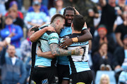 Edrick Lee of the Sharks celebrates scoring a try with Josh Dugan and Chad Townsend of the Sharks during the round 24 NRL match between the Cronulla Sharks and the Newcastle Knights at Southern Cross Group Stadium on August 26, 2018 in Sydney, Australia.