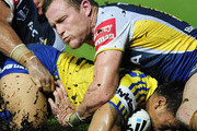 Johnathan Thurston and Gavin Cooper of the Cowboys tackles Ken Sio of the Eels during the round three NRL match between the North Queensland Cowboys and the Parramatta Eels at Dairy Farmers Stadium on March 17, 2012 in Townsville, Australia.