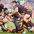 Greg Inglis Photos - Greg Inglis of the Rabbitohs takes on the defence during the round eight NRL match between the Brisbane Broncos and the South Sydney Rabbitohs at Suncorp Stadium on April 22, 2016 in Brisbane, Australia. - NRL Rd 8 - Broncos v Rabbitohs