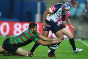 Greg Inglis of the Rabbitohs beats Johnathan Thurston of the Cowboys to the ball to score a try during the round nine NRL match between the South Sydney Rabbitohs and the North Queensland Cowboys at ANZ Stadium on May 10, 2013 in Sydney, Australia.