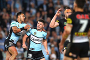 Chad Townsend of the Sharks celebrates kicking a field goal with team mate Valentine Holmes during the NRL Semi Final match between the Cronulla Sharks and the Penrith Panthers at Allianz Stadium on September 14, 2018 in Sydney, Australia.