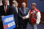 FealGood Foundation co-founder John Feal (R) thanks (R-L) Sen. Robert Menendez (D-NJ), Sen. Mark Kirk (R-IL) and Sen. Chuck Schumer (D-NY) after the Zadroga 9/11 health and compensation programs were included in the omnibus spending bill that passed Congress at the U.S. Capitol December 18, 2015 in Washington, DC. With a public awareness campaign lead by former Daily Show host Jon Stewart, the Zadroga legislation will provide money for healthcare for first responders and others suffering from diseases from the 9/11 attacks and for the families of those who have died.