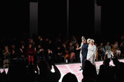 Designer Naeem Khan (2ndL) walks the runway with models Pat Cleveland, Alva Chinn and Karen Bjornson at the Naeem Khan show during New York Fashion Week: The Shows at Gallery I at Spring Studios on February 12, 2019 in New York City.