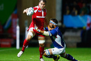 Giorgi Nemsadze of Georgia is tackled by PJ Van Lill of Namibia during the 2015 Rugby World Cup Pool C match between Namibia and Georgia at Sandy Park on October 7, 2015 in Exeter, United Kingdom.